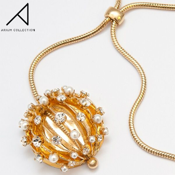 This intricate necklace from our Eclipse Collection exudes femininity with its curves and pearl accents. A great accent on a colour-block dress or tailored shirt!  Materials: 16K gold plated brass, costume pearls, Czech Preciosa crystals. Stone setting handmade in the specially designed cast.  #ariumcollection #handcraftedjewellery #necklace
