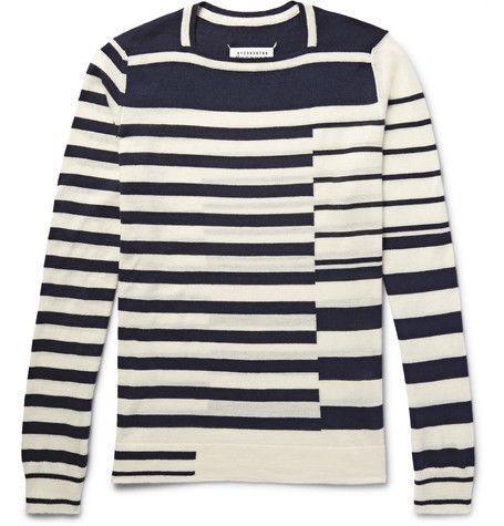 Designed in broken stripes, this Maison Margiela sweater feels thoroughly modern. It's knitted from insulating wool and has a square neckline that furthers its appeal. The midnight-blue and cream palette makes it extremely wearable.