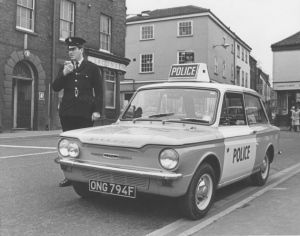 PC ID McRae of Norwich City Police poses beside his newly-acquired Panda car on the first day of the new Panda Patrol on the junction of Duke Street and St Andrews Street in Norwich in February 1968.