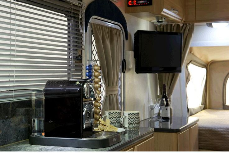 Now this is camping. A Coffee Machine, LCD TV/DVD and sound system with external speakers  #campingmadeeasy