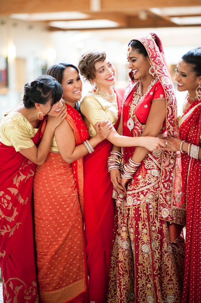 Bridesmaids in red sarees.