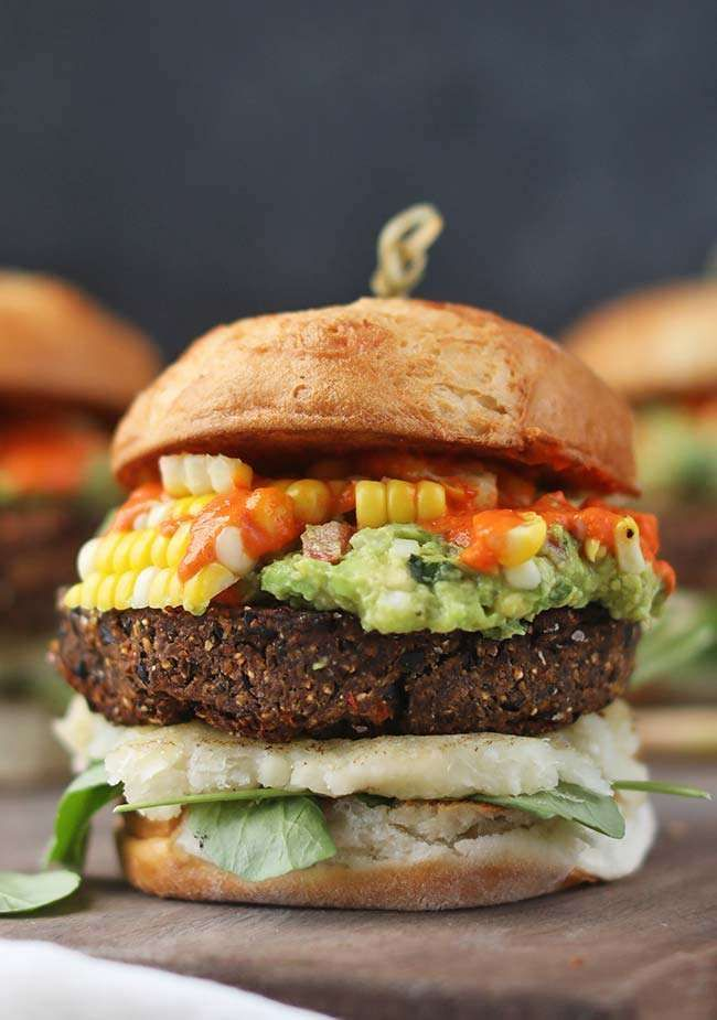 Make this delicious Vegan Black Bean Burger Recipe with Yucca and Guacamole with gluten-free bun and chipotle spike tomato sauce!