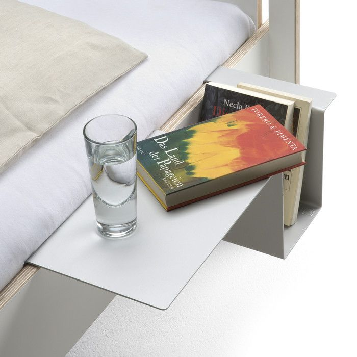 A cool modern alternative to a bedside table, this metal holder attaches to the side of your bed and can hold a few books, a glass and a few small items.