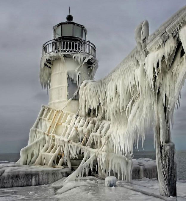 Winter storm waves turns 2 century-old lighthouses into Cthulhu-like structures.  Photographers Thomas Zakowski and Tom Gill ventured out to 2 lighthouses at the St. Joseph North Pier on the coast of Lake Michigan when walkways froze over. And thankfully, they pulled out their cameras to document nature's frigid masterpiece.  Known for their spectacular icicles, the lighthouses have become an unlikely winter destination for tourists. And based on the breathtaking images below, we can see…