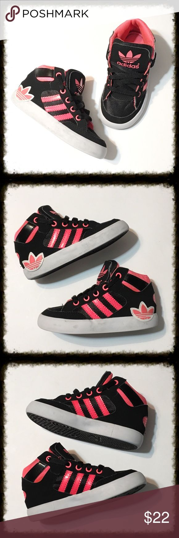 Pink and Coral Adidas Hi Top Sneakers In excellent condition with very light signs of wear. Size 7 kids. Color is a pinkish coral on black. Adidas Shoes Sneakers