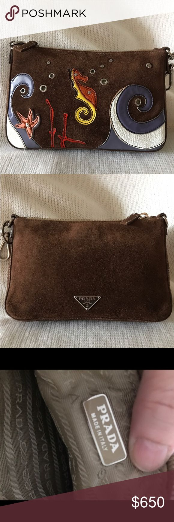 🌊Prada Clutch🌊 Authentic Prada Clutch. Preloved adorable chocolate suede clutch with patent leather seahorse and waves. Quirky rare fun item. Attach a strap if you want to use as a crossbody. It has a key ring and clasp on one end. Outside is clean. Inside has a few smudge marks from light use. No trades! Silver hardware Prada Bags Clutches & Wristlets