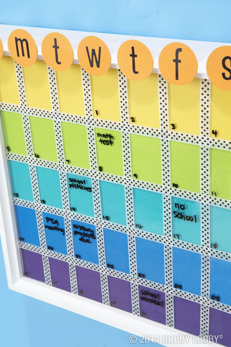 With just some rainbow shades of paper, designer tape and a few stickers, we turned a standard-issue frame into the coolest, most colorful calendar this side of the cafeteria. TIP: Dry erase markers wipe right off the glass!