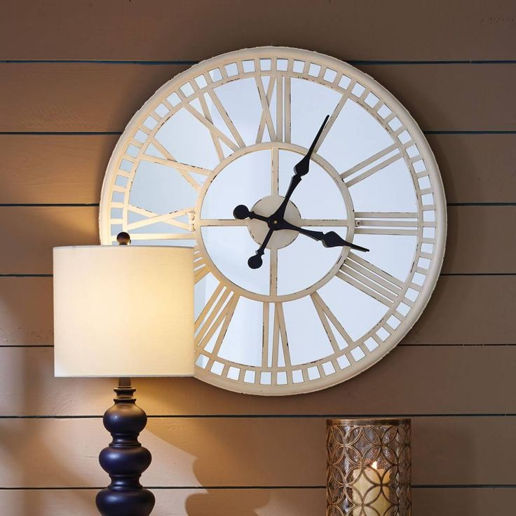 """Old meets new in this stunning Mirror Clock; easily making this the focal point of any room. This open framed cream colored clock with roman numerals overlays a mirror for a unique, contemporary twist. Measures 28"""" x 2.75"""" x 28"""". #farmhouse #decor #clock"""
