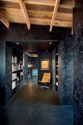 Walls, shelving and ceiling in this study area are made from OSB stained black.