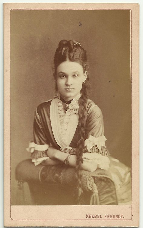 Young woman in a cabinet photo
