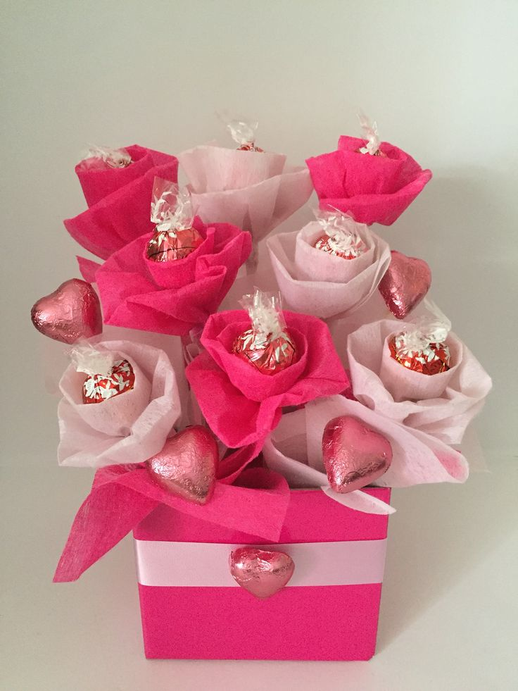 Pink Lindt bouquet! $30 Other colours can be done. 10 Lindt chocolates 5 Cadbury heart chocolates Private message to order!