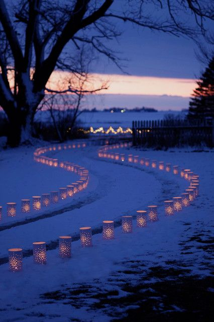 Simply tin can pin hole lights - lovely.  (From The Best 40 Outdoor Christmas Lighting Ideas That Will Leave You Breathless)