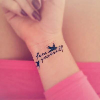 free yourself schwalben tattoo