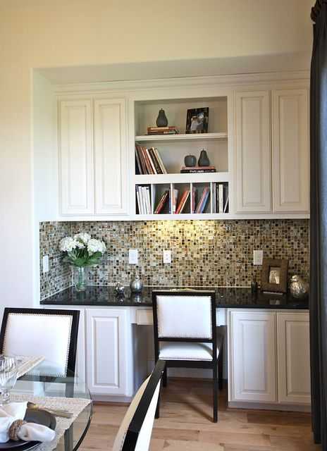 what about doing something like this in the dining room rather than a hutch as a sideboard - with a little desk/bill pay area