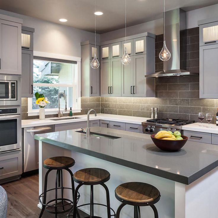 Lighted upper cabinets hold inset resin panels, a ...