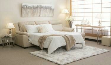 By Dezign Harper chaise sofa bed. Also in soft grey.