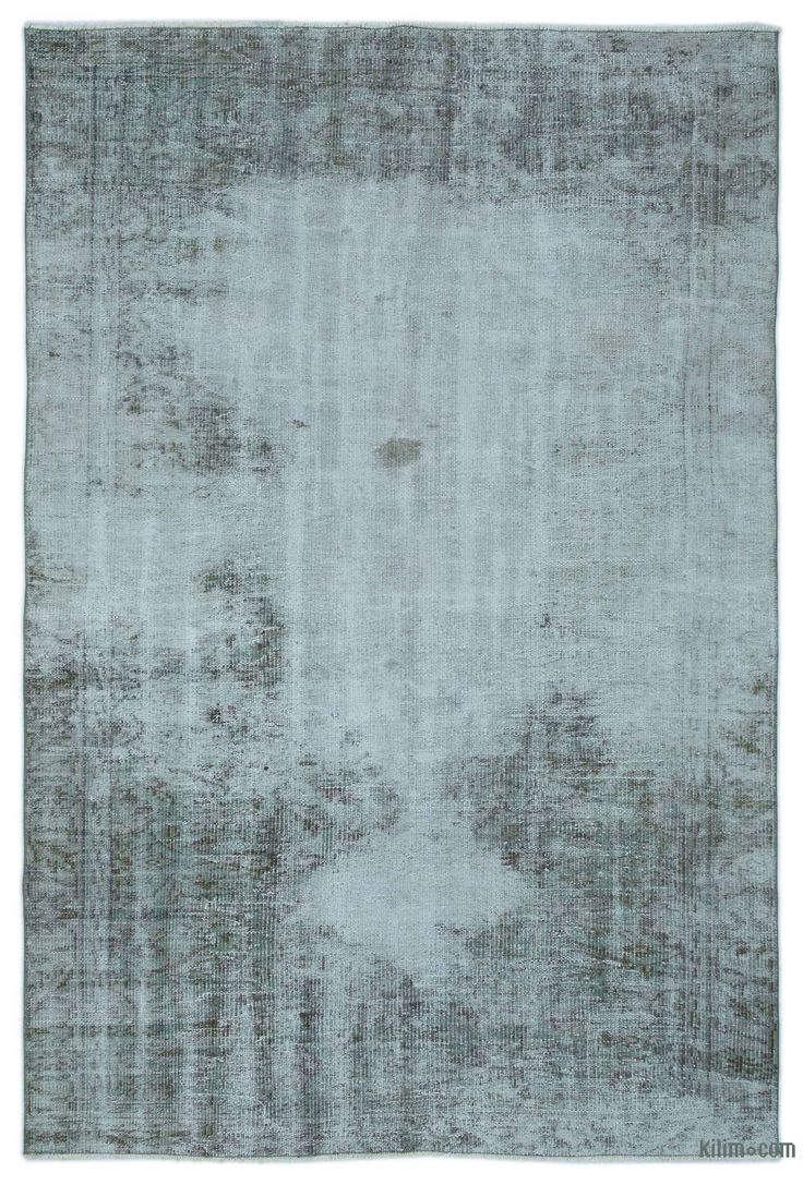 "For a contemporary look with abstract appeal, this blue over-dyed rug is skillfully crafted by the revitalization of a hand knotted vintage Turkish rug. Made from wool on cotton, this ""distressed"" rug measures 156 cm x 240 cm. The process in creating these works of art begins by shearing to lower the pile and to help ""distress"" them. They then undergo a series of processes to remove the color. They are now ready to be dyed in one color, a stage that can be repeated several times to reach th…"