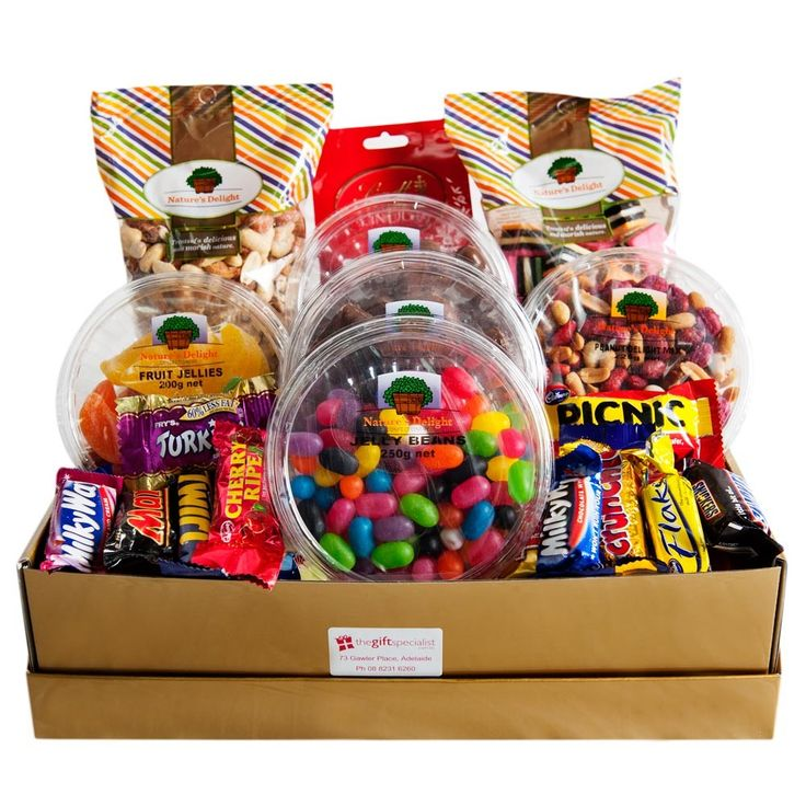 Naughty Nibbles Gift - Bag of Lindt Milk Chocolates 125g, Fruchocs 175g, Fruit Jellies 200g, Peanut Delight 200g, Jelly Beans 250g, Chocolate Honeycomb 175g, Licorice Allsorts 275g, Mixed Nuts Roasted Salted 500g & 14 pick 'n' mix fun size chocolates. This delicious pack comes gift wrapped in a gloss box with cellophane & ribbon.