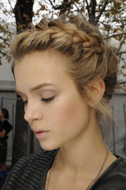 begin by parting your hair to the side.  Then, section off a large portion of your hair (3 1/2 to 4 wide) and begin french braiding along your hairline. Be sure to keep from pulling the braid too tight, as youll lose the messy volume look.  Braid until the braid reaches just past your ear and secure with a small clear rubberband (I find them in packages of 100 at Walmart for cheap).   Once secure, wrap the remaining hair into a messy bun, wrapping a piece around your hairband to conc