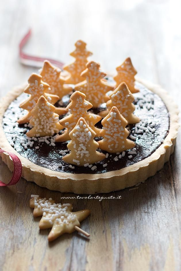 Christmas Tart (Chocolate and Cinnamon) covered with cookies in the shape of trees - Christmas Tart Recipe