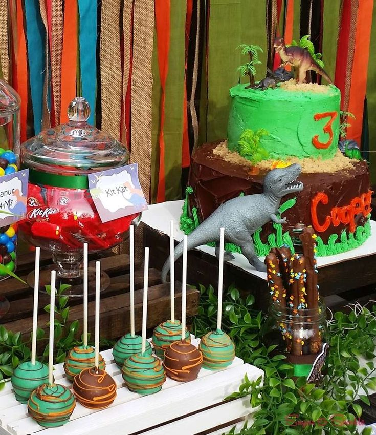 Dinosaurs birthday party cake pops!  See more party planning ideas at CatchMyParty.com!