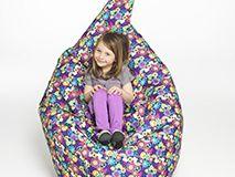 girl sitting in kid-friendly bean bag chair