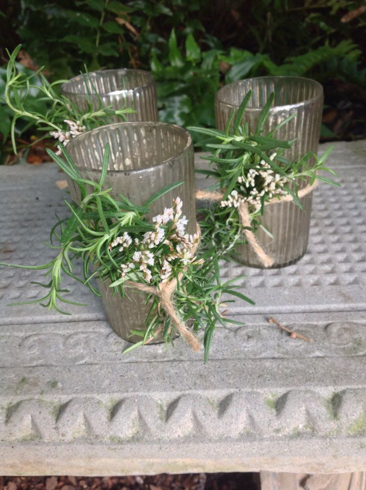 Mercury glass votives wrapped in rosemary and twine.