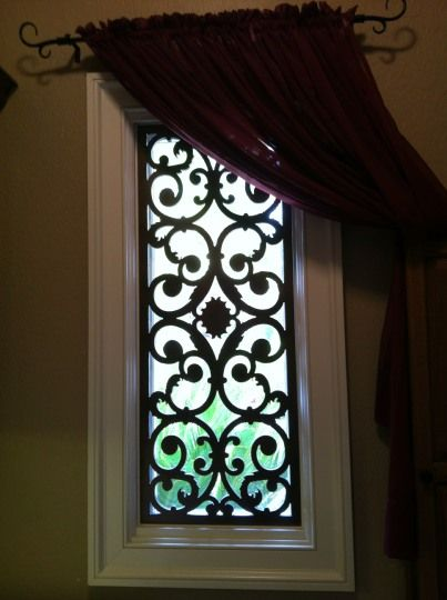 faux Wrought iron window treatment for transoms? would be neat to match balcony railings.