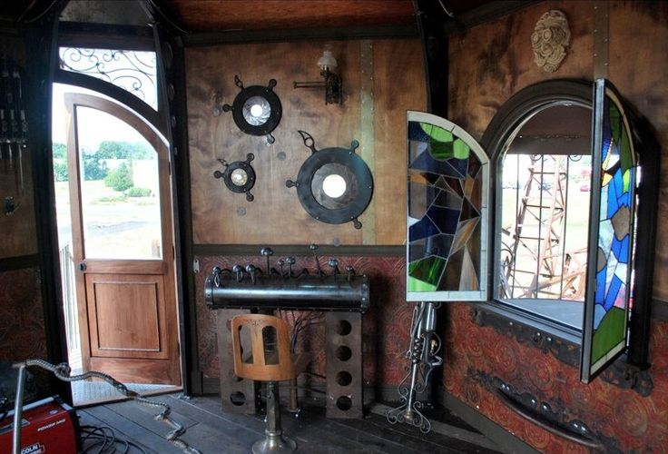 While some fans of the steampunk aesthetic might reflect their love of brass and steam with their clothing, accessories, or a few well chosen household items, others take the look a bit farther, redesigning entire home, office, and business interiors to look like something from a nonexistent version of the Victorian past.