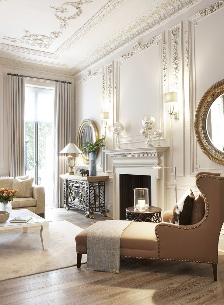Description Beautiful White Interior With Classic Architectural Embellishments Elaborate Wall And Ceiling Panels Cove Molding Fireplace Mantel Is