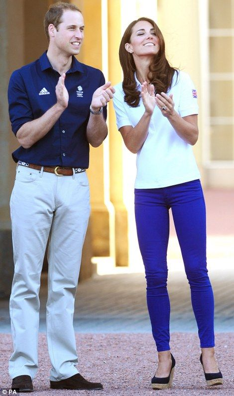 The Duke and Duchess of Cambridge greet the Olympic flame / July 26, 2012