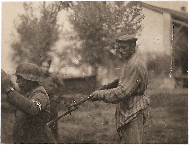 Liberated Jewish Concentration Camp Prisoner holding Nazi Soldier at the end of a Bayonet.