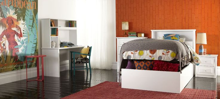 Odyssey White Gas Lift Kids bed and bedroom furniture suite, with bright bold patterned linen and décor. Available at forty Winks.