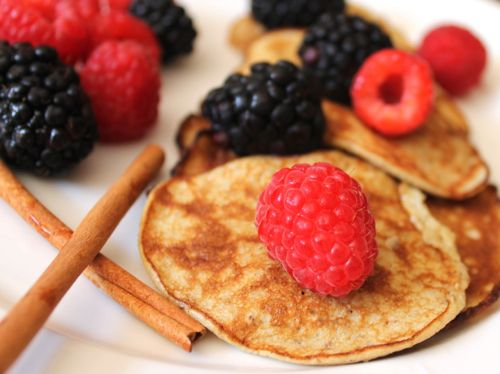 Banana and egg protein pancakes with berries