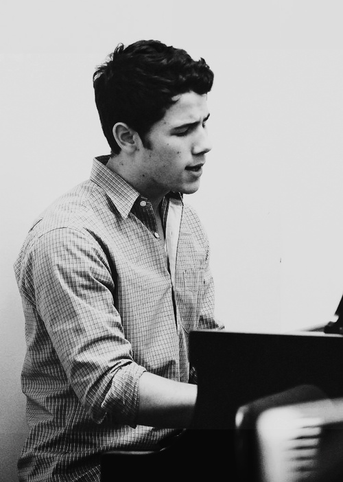 Nick Jonas...and he's behind a piano. This makes him so much more attractive!!!