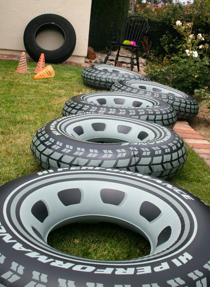 Hot Wheels Party for J's 6th Birthday!  Tire toss game: obstacle of inflatable tires (Amazon) followed by a tire toss (into a real tire with Target dollar bin balls).  Prize = candy!