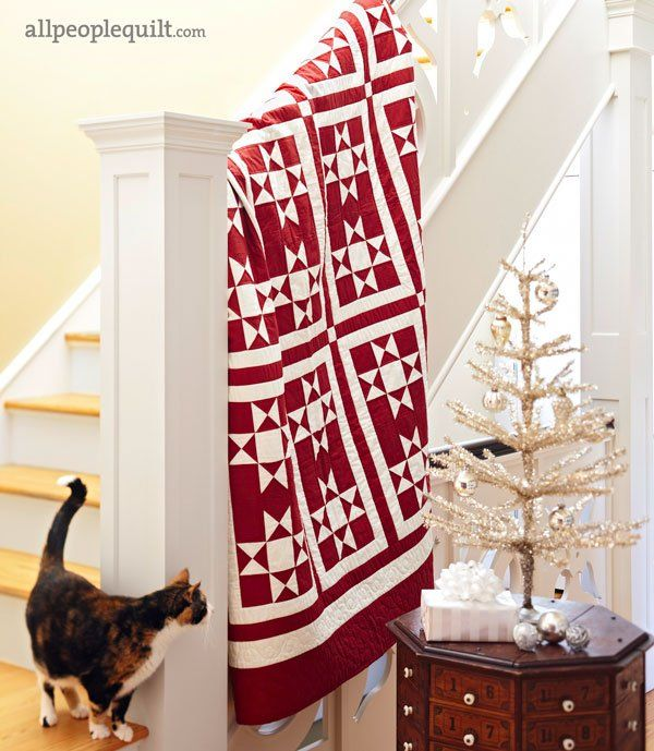 The classic red-and-white combo and traditional-with-a-twist star blocks make  the quilt a winner year-round.