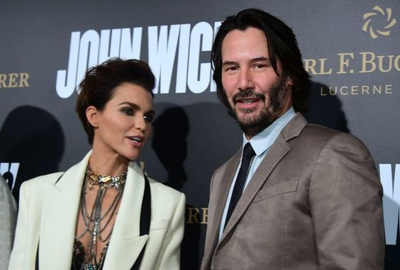 """From the cast, actor Keanu Reeves and actress Ruby Rose pose on arrival for the premiere of the film """"John Wick Chapter Two"""" in Hollywood, California on January 30, 2017. / AFP / Frederic J. Brown - Premiere Of Summit Entertainment's 'John Wick: Chapter Two' - Arrivals:"""