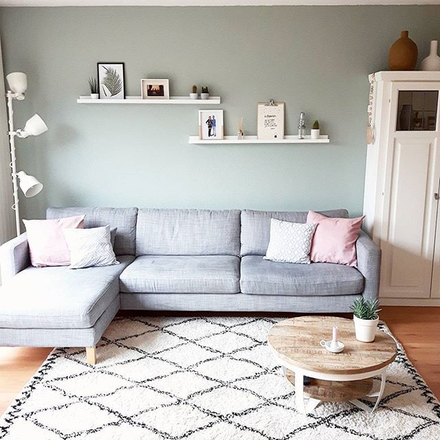 Digging the feel of this corner couch with small coffee table.