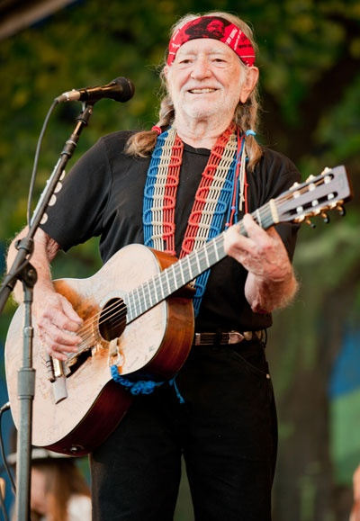 willie nelson looking awesome as usual in a headband and a stylish guitar strap jazzfest. Black Bedroom Furniture Sets. Home Design Ideas