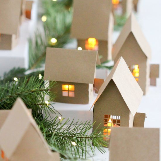 Free tutorial and cutting files to make these paper advent Christmas houses!
