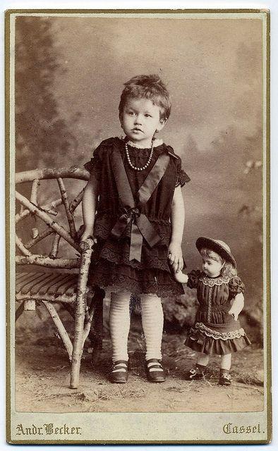 Little girl with wonderful old doll by josefnovak33