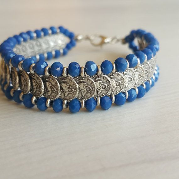 Check out this item in my Etsy shop https://www.etsy.com/listing/263507844/blue-beaded-charm-bracelet-charms