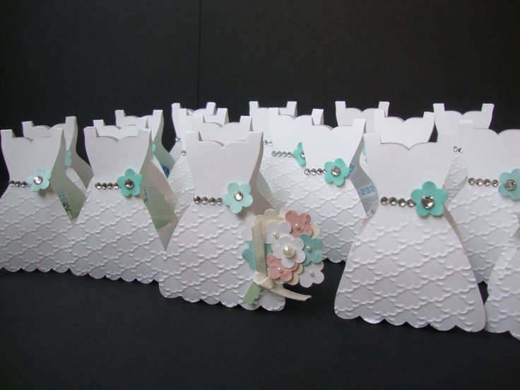 Bridal Shower party favor idea - use the Stampin' Up! Dress framelit (on a fold) with small card stock box inside (holds 2 Hershey kisses). Dresses are embellished with rhinestones and punched flowers.
