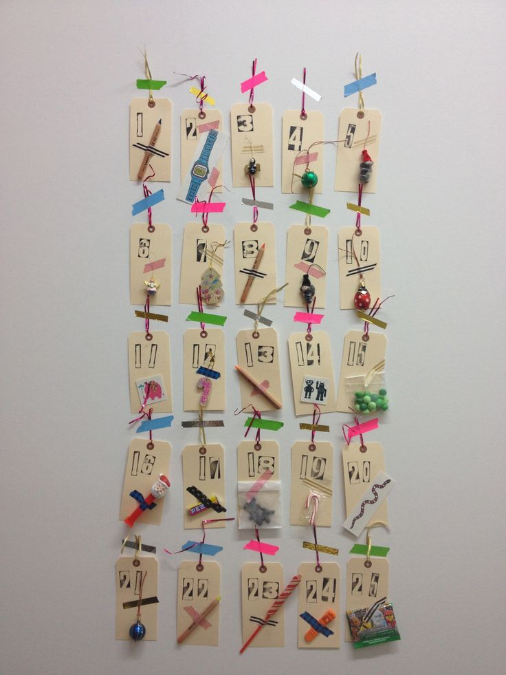 DIY Advent Calendar - our not so traditional advent calendar. Goodies include - mini ornaments for the tree in their room, Tattly Tattoos, Ferby colored pencils, and mint flavored M&M's etc. Made by Sheryl Cancellieri