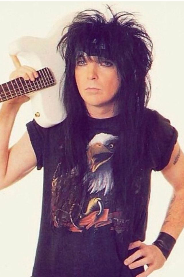 Mick Mars - mad respect for this guy. Not only is he a boss on the guitar but for him to keep gettin' up on stage every freakin; day with all the pain he is in and all the health problems from  A.S. deserves the love.