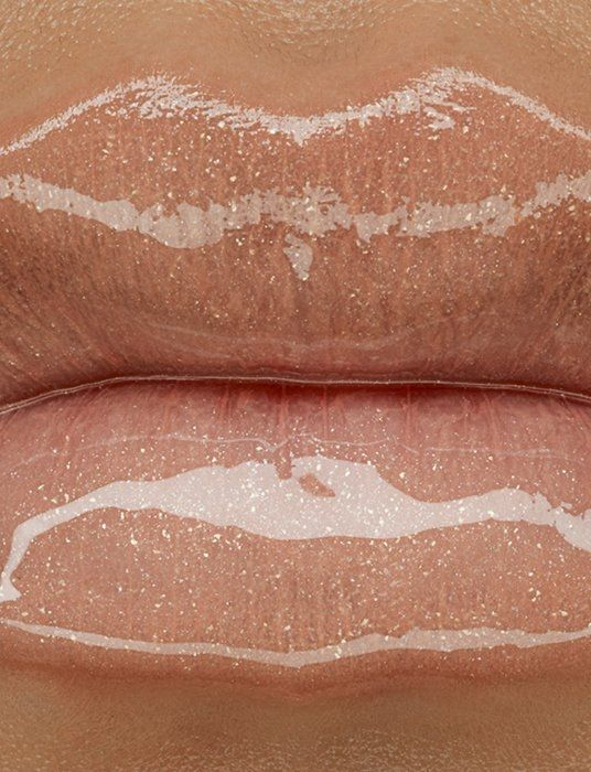 If you like shiny, glossy, sparkling, nude lips I guess this would be the answer: MAC Cremesheen Pearl Fall 2012