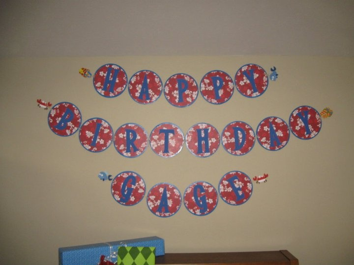First Birthday Party - Results of my Pinning:  Happy Birthday Banner made out of cake rounds, scrap book paper, and letters cut out of foam sheets, and all tied together with raffia.