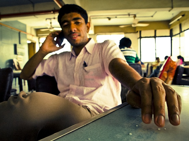 Pheroze on the phone at the Indian Coffee House in Connaught Place, New Delhi...