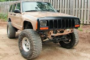 Check out part 2 of our disposable hero project as we upgrade the exhaust, body protection and add a winch to our 1999 Jeep Cherokee XJ.